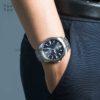 Đồng hồ Citizen CB0011-51L đeo trên tay